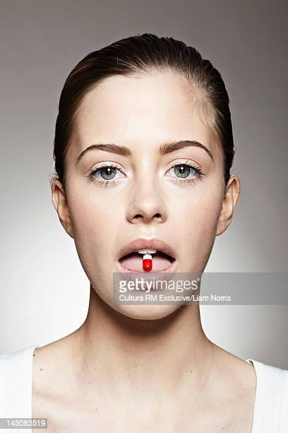 Close up of woman taking pill