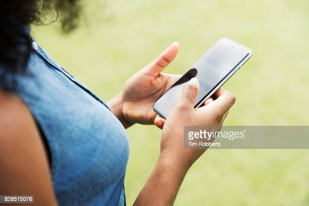 Close up of woman using smart phone