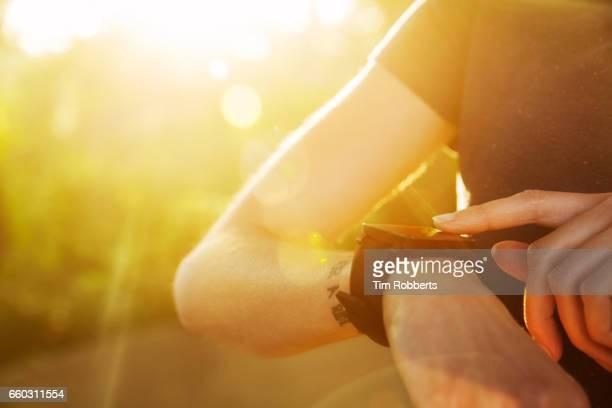 Close up of woman using smart watch