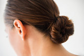 Close up of woman wearing bun in hair