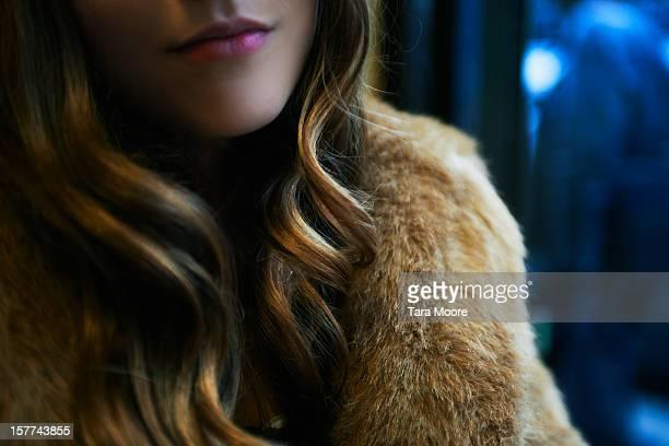 close up of woman wearing fur jacket