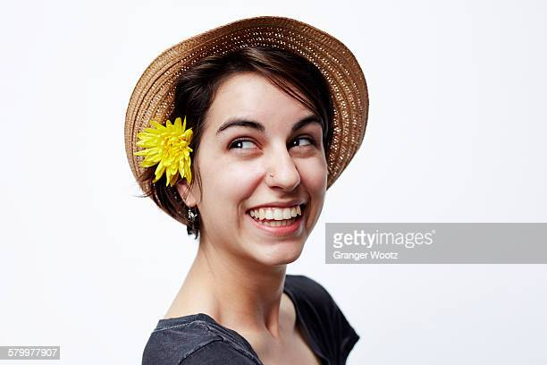 Close up of woman wearing straw hat