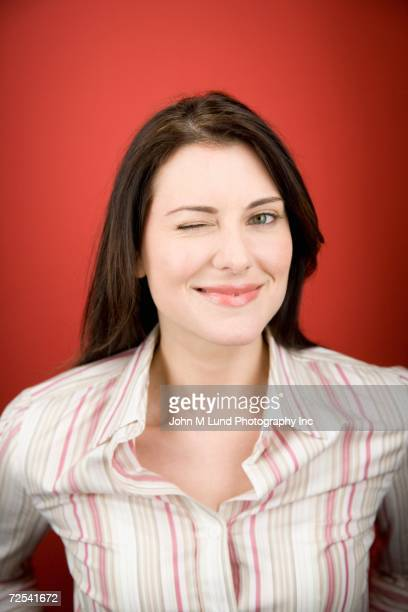 Close up of woman winking
