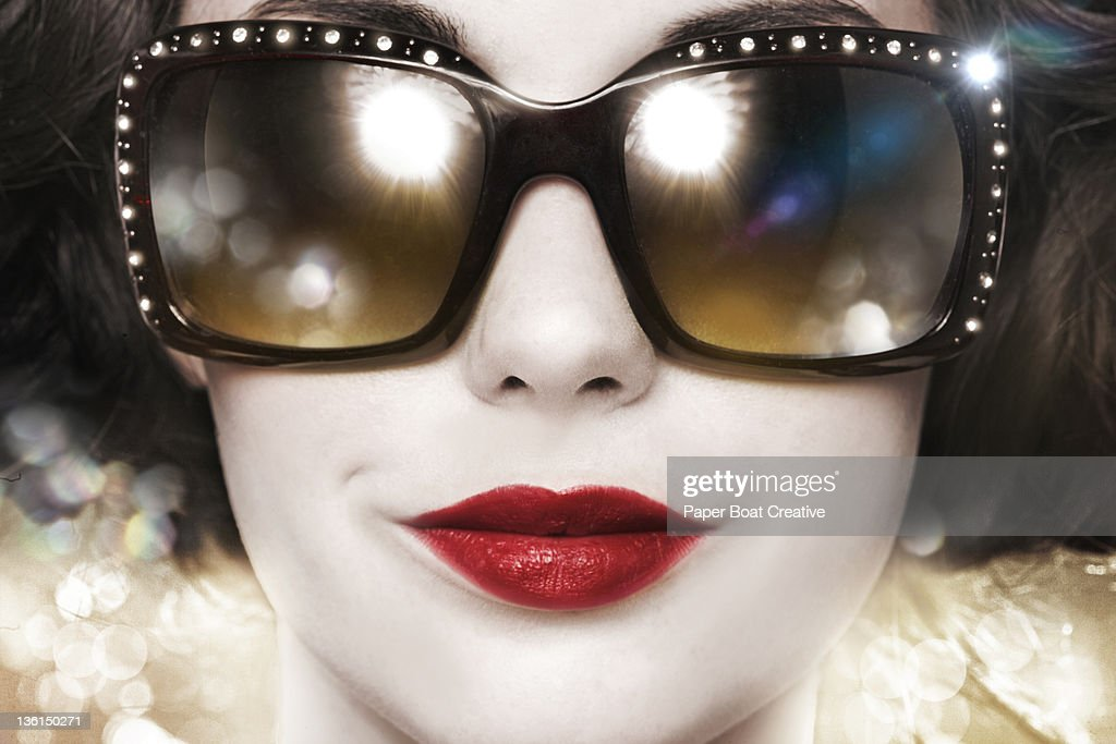 Close up of woman with designer sun glasses