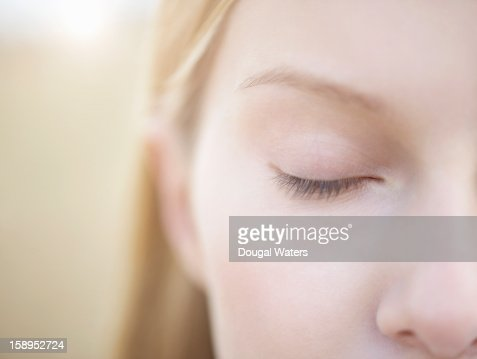 Close up of woman with eye closed.