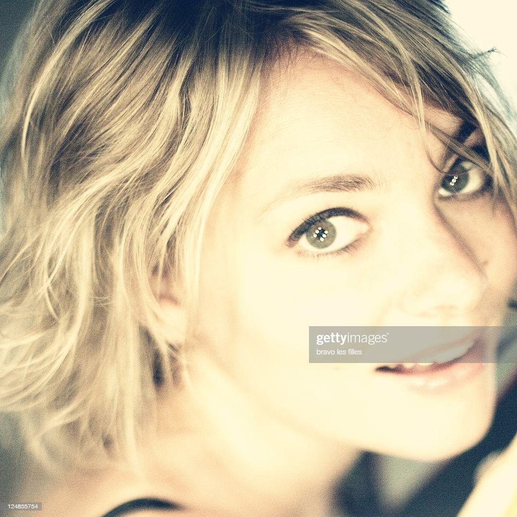 Close up of woman with toothy smile : Stock Photo
