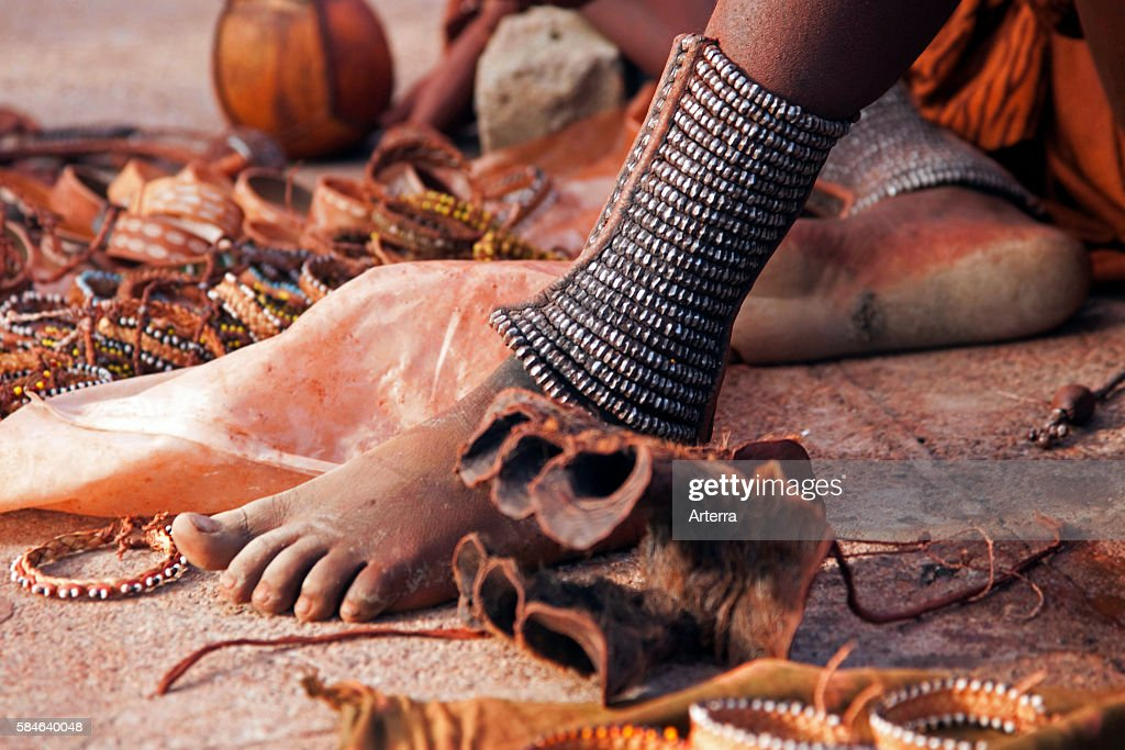 Close up of woman's feet decorated with anklets and jewellery of the Himba tribe Namibia South Africa