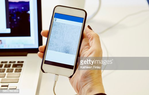 Close up of womans hand holding smartphone with blank screen