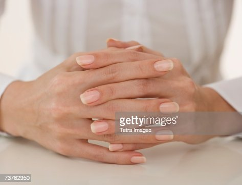 Close up of woman's hands clasped
