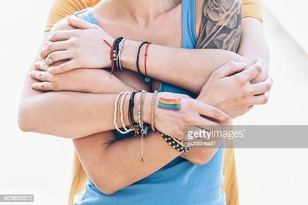 Close up of women embracing on bridge