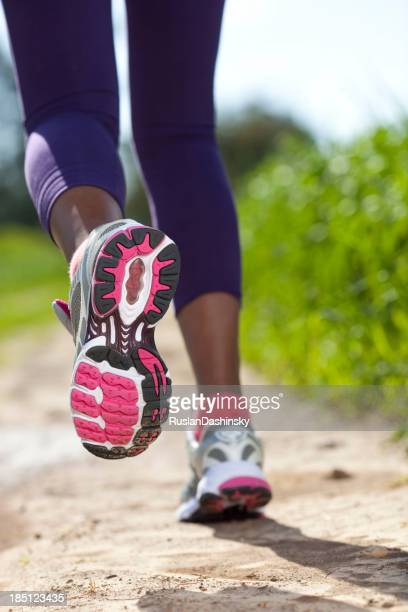Close up of women sport shoes running outdoors.