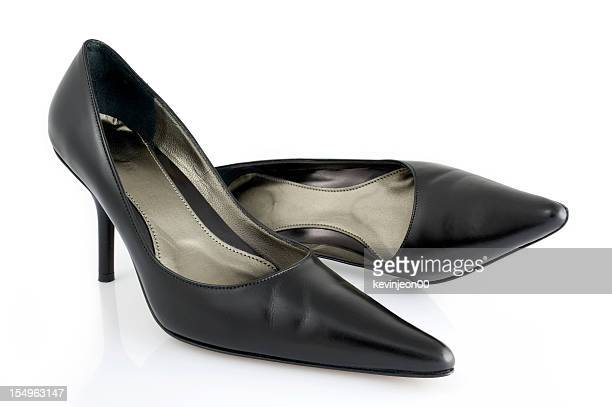 A close up of women's black high heel shoes