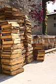 Wooden barrels and crates as equiment for home wine production.