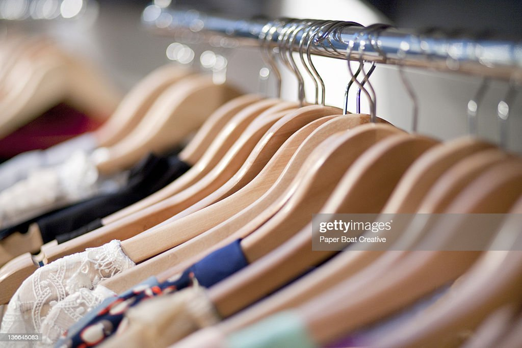 close up of wooden clothes hangers in a shop : Stock Photo
