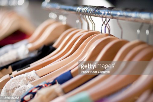 close up of wooden clothes hangers in a shop stock photo getty images. Black Bedroom Furniture Sets. Home Design Ideas