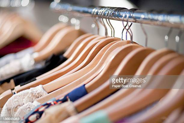close up of wooden clothes hangers in a shop