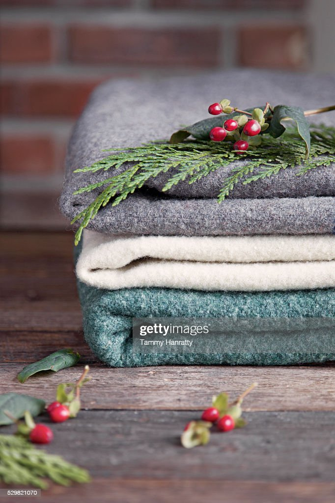 Close up of woolen blankets and leaves : Stock Photo