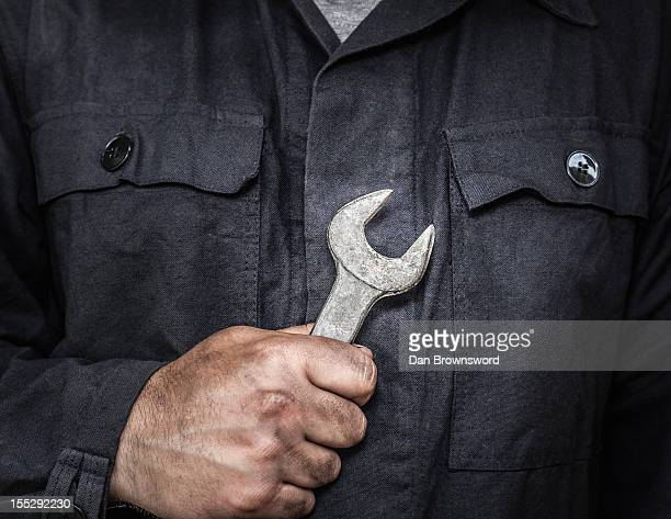Close up of worker holding wrench