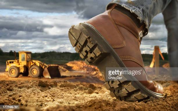 Close up of worker's boot on construction site