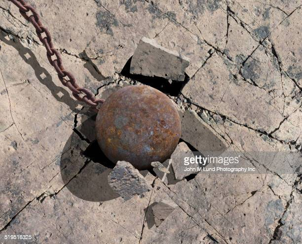 Close up of wrecking ball cracking concrete