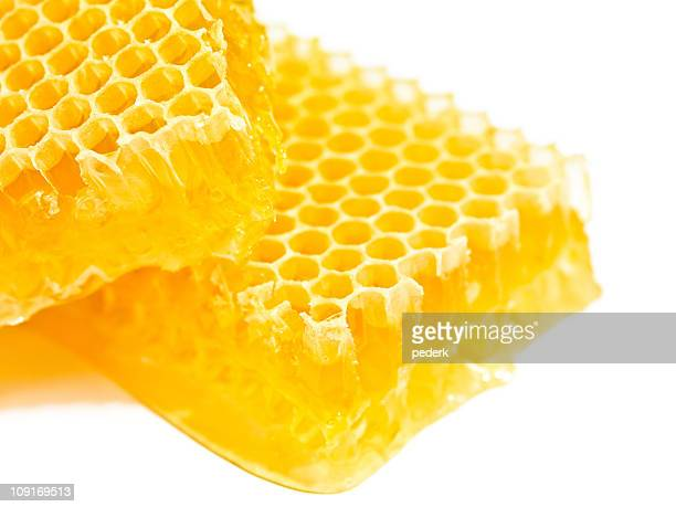 Close up of yellow honeycomb on white