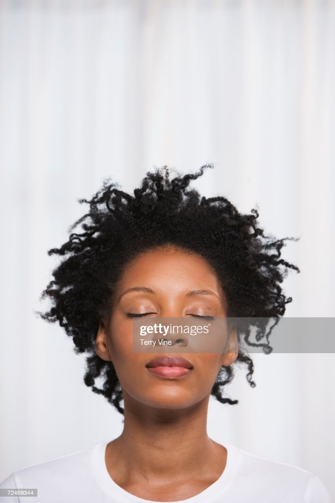 Close up of young African woman with eyes closed : Stock Photo