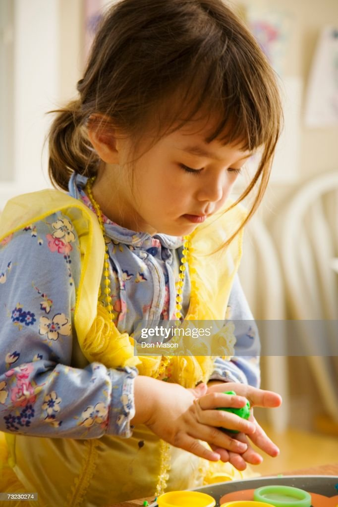 Close up of young Asian girl playing with clay : Stock Photo