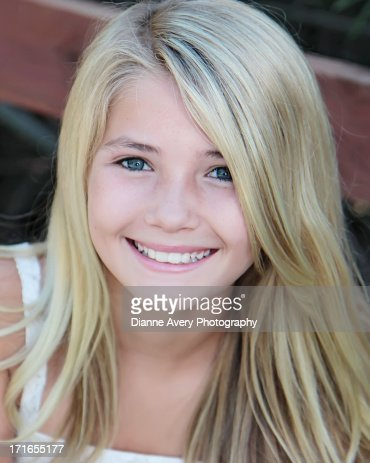 Close Up Of Young Blond Girl Big Blue Eyes Photo Getty