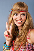 Close up of young hippie woman showing peace sign, smiling, portrait