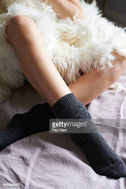 close up of young lady in comfy socks