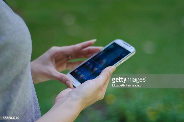 Close up of young woman holding a smartphone