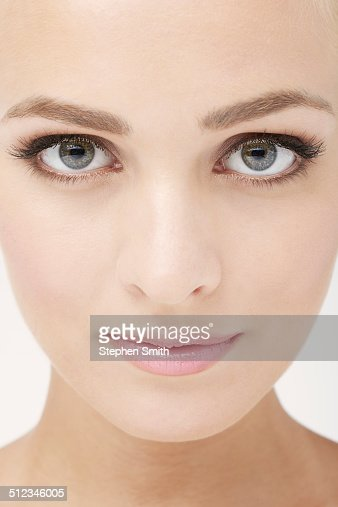 Close up of young woman looking to camera