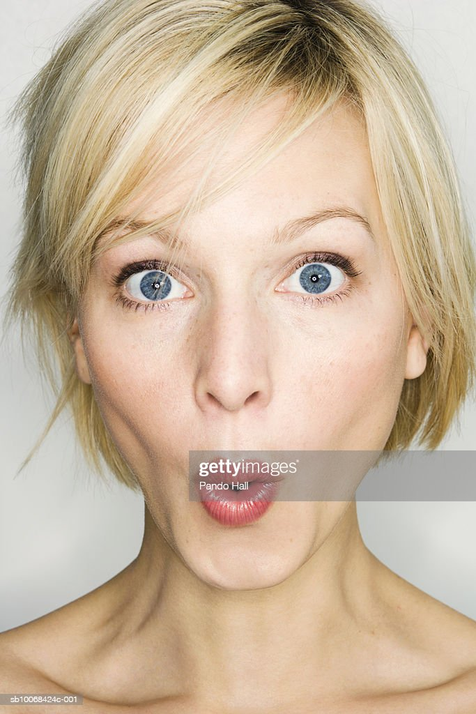 Close up of young woman making face, studio shot