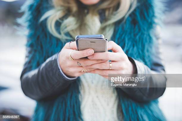 Close up of young woman texting on smartphone, Lake Como, Como, Italy