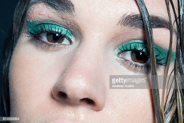 Close up of young woman's eyes and wet skin.