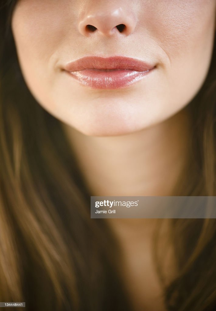Close up of young woman's lips : Stock Photo
