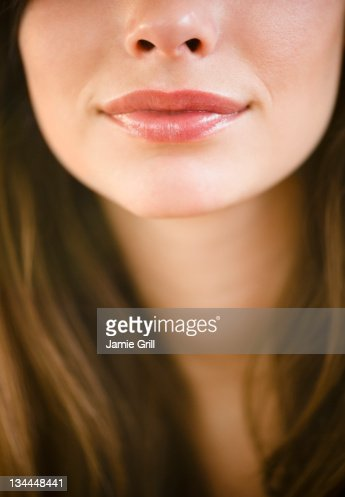 Close up of young woman's lips : Foto de stock
