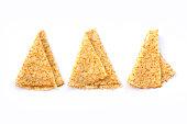 Close up on 3 folded crepes (french pancakes) isolated on white background