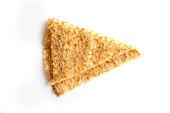Close up on a folded crepe (french pancake) isolated on white background