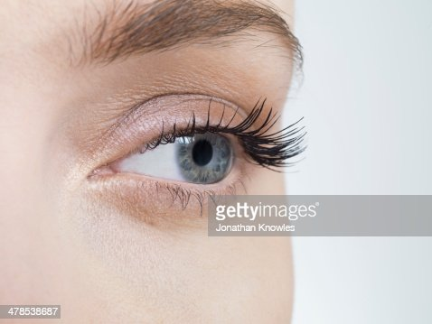 Close up on an female eye, looking away : Stock Photo