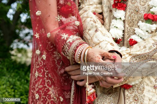 close up on hands of a married Indian couple