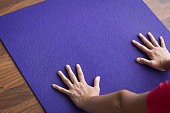 Female yogi practices adho mukha svanasana pose. Focus, concentration, healthy lifestyle concepts