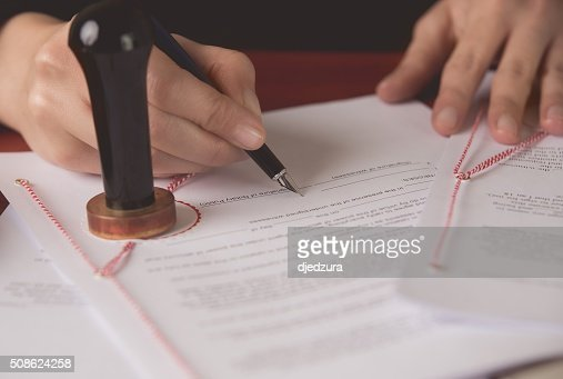 Close up on notaries public hand signing the testament : Stock Photo