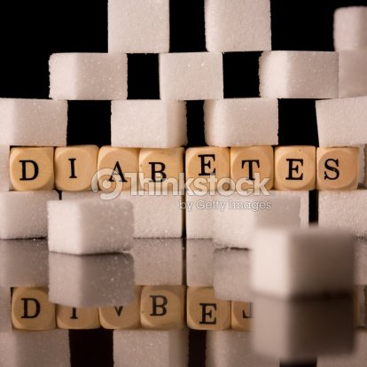 Close up on sugar cubes and dice spelling diabetes : Stock Photo