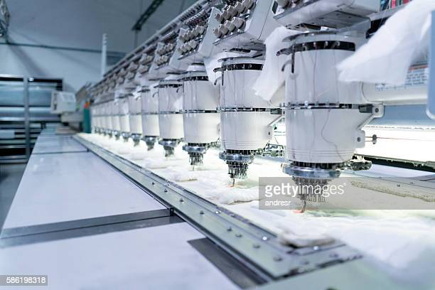 Close up on the embroidery machine at a clothing factory