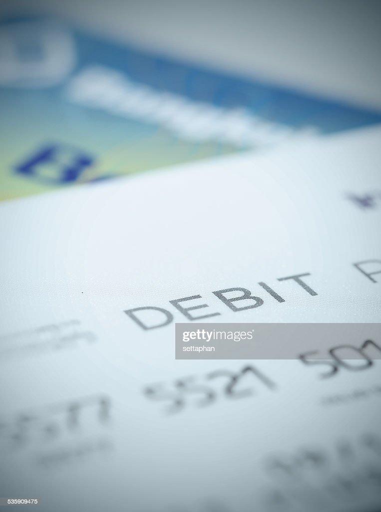 Grande plano de parte de cartão de débito de fundo sobre finanças : Foto de stock