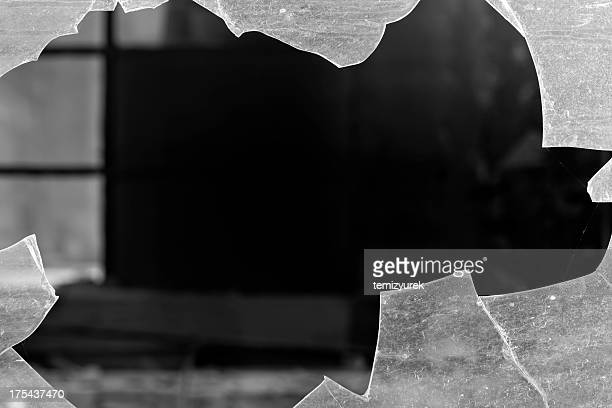 Close up photo of a hole in a broken window
