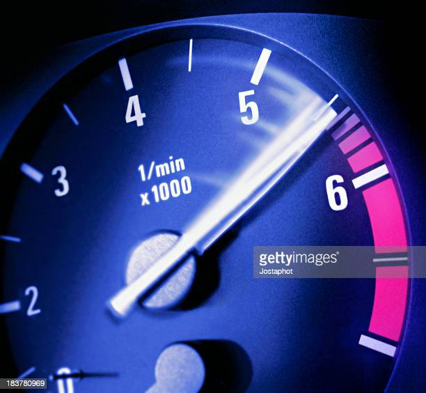 Close up photo of a tachometer  needle moving