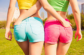Close up photo of beautiful shapely woman in shorts