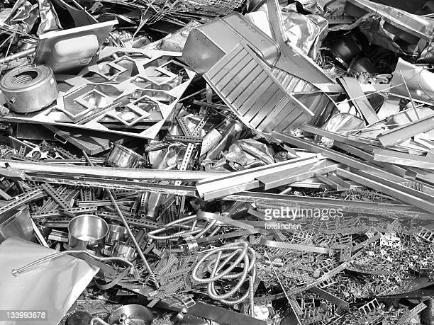 Close up photo of silver color scrap metal and metal trash